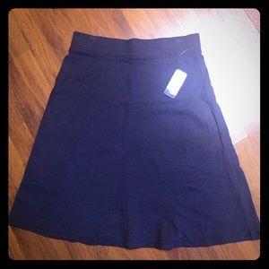 Indigo Knee length skirt. NWT. Dark Blue.